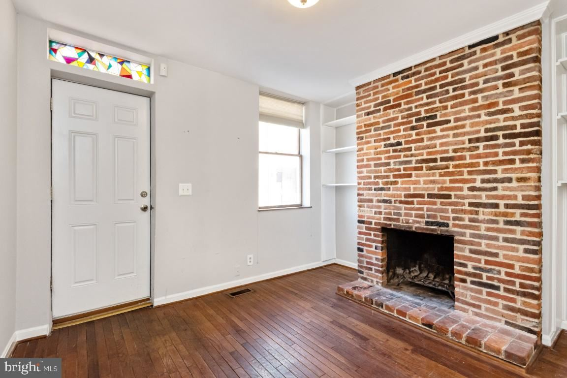 Photo of 207 GRINDALL ST, BALTIMORE, MD 21230 (MLS # MDBA2000228)