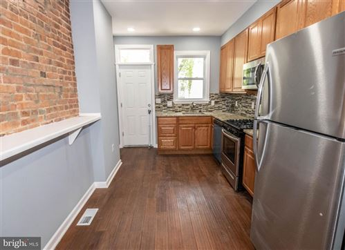 Photo of 405 WHITRIDGE AVE, BALTIMORE, MD 21218 (MLS # MDBA511248)