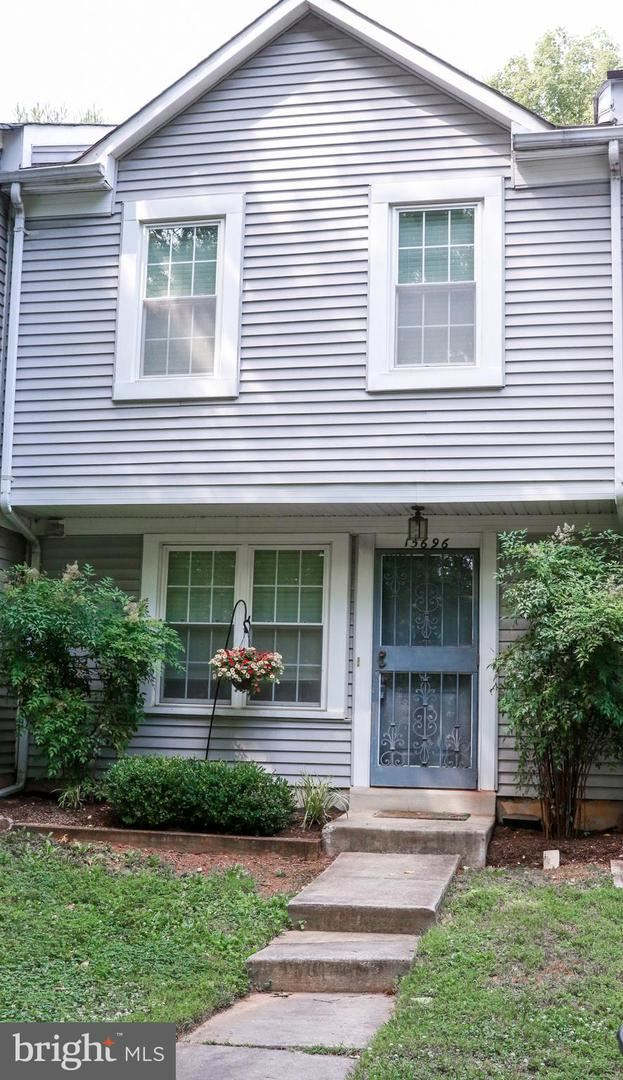 Photo of 15696 CLIFF SWALLOW WAY, ROCKVILLE, MD 20853 (MLS # MDMC713266)