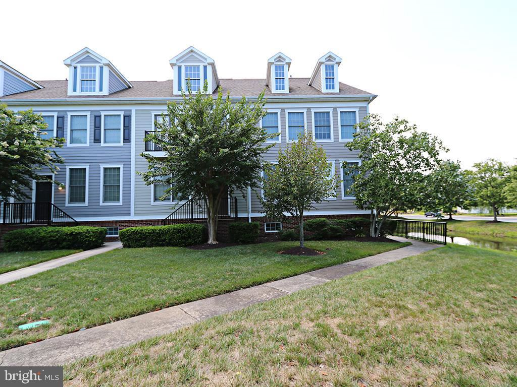 Photo of 4 VILLAGE GREEN DR, OCEAN VIEW, DE 19970 (MLS # DESU166284)