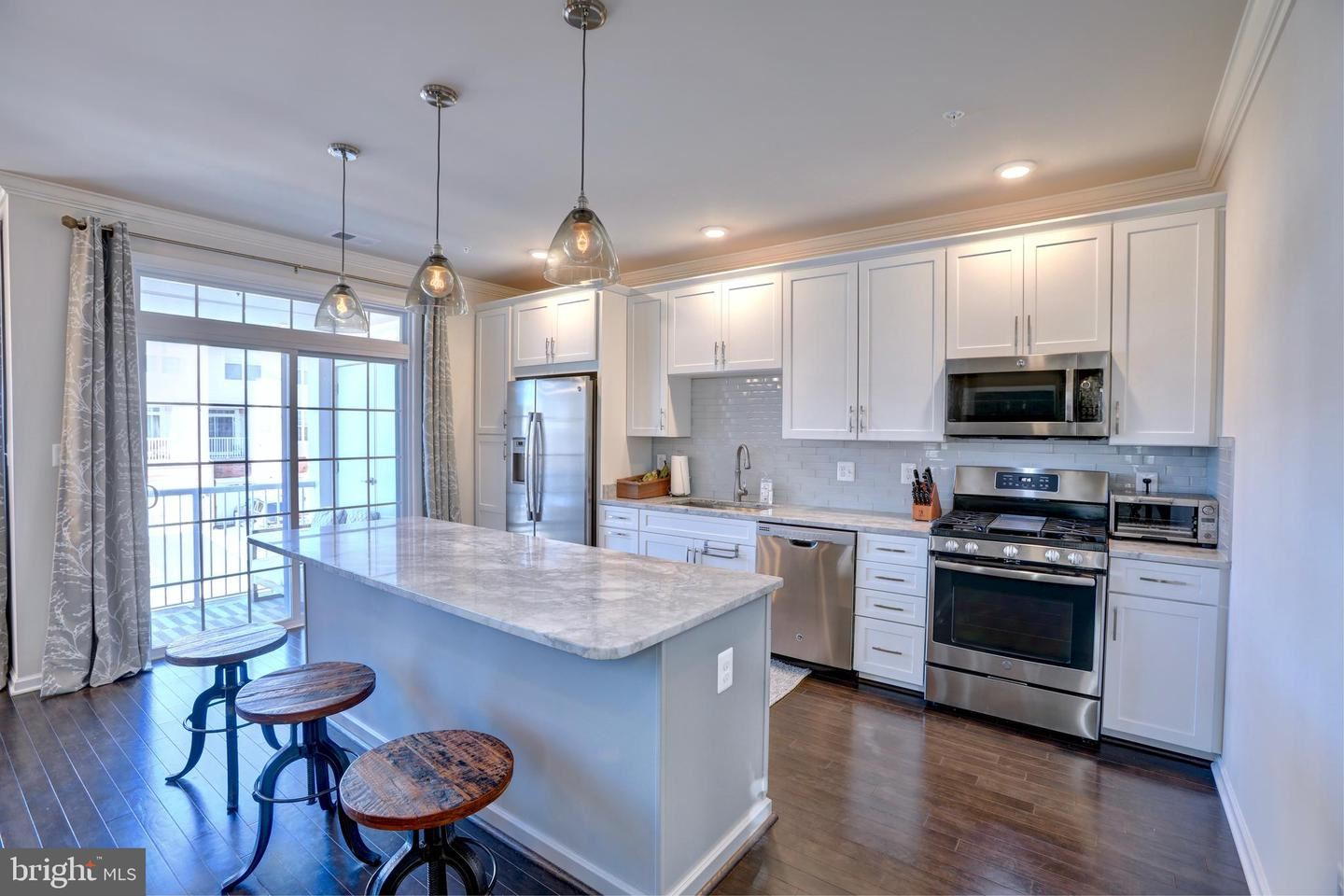 Photo of 23276 SOUTHDOWN MANOR TER #114, ASHBURN, VA 20148 (MLS # VALO426294)
