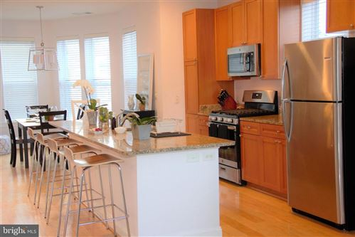 Photo of 1633 N COLONIAL TER #201, ARLINGTON, VA 22209 (MLS # VAAR158298)