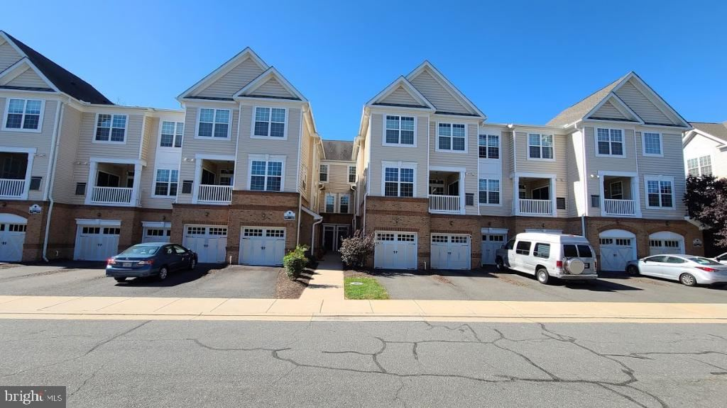 Photo of 20375 BELMONT PARK TER #110, ASHBURN, VA 20147 (MLS # VALO426302)
