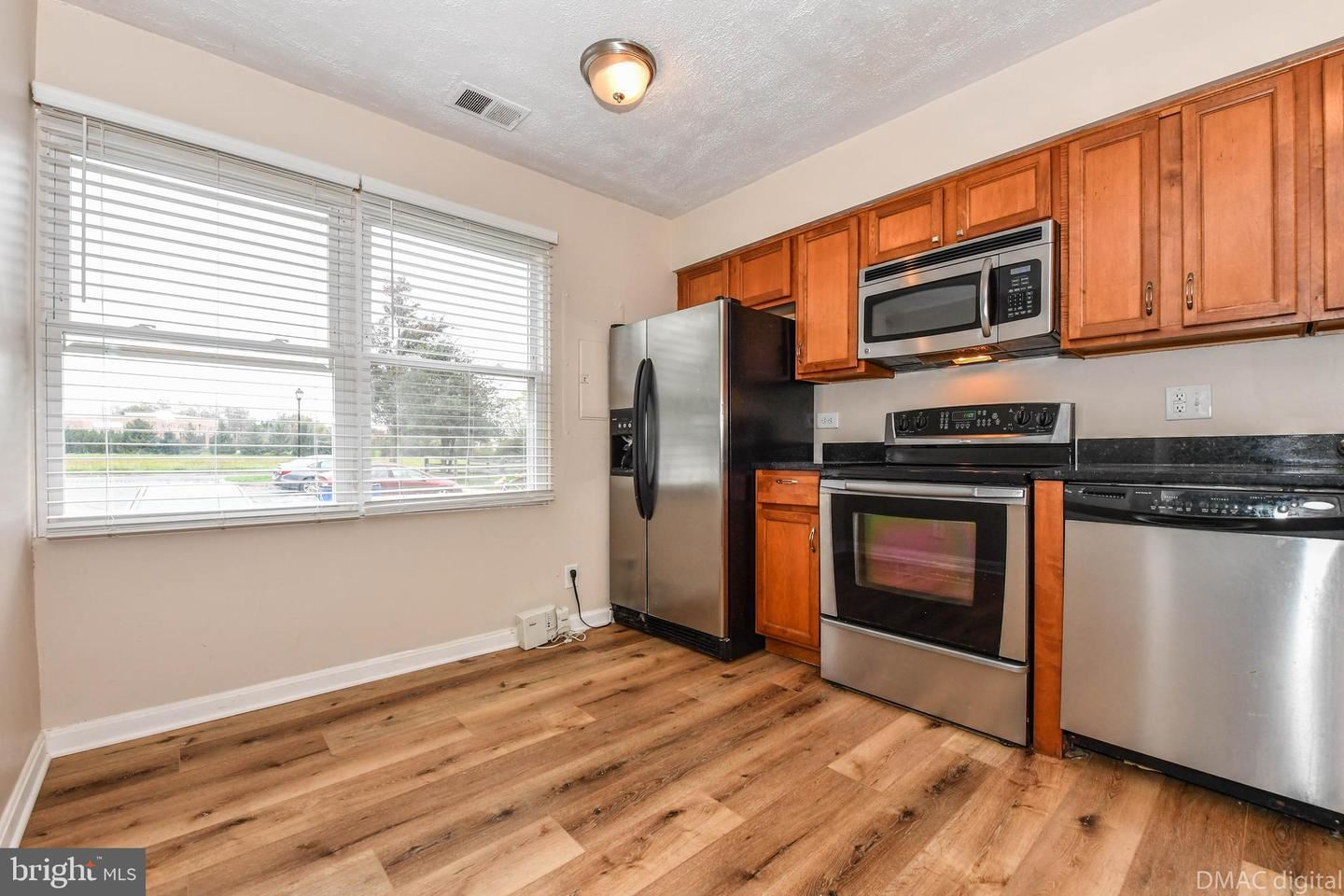 Photo of 19620 WOOTTON AVE, POOLESVILLE, MD 20837 (MLS # MDMC732312)