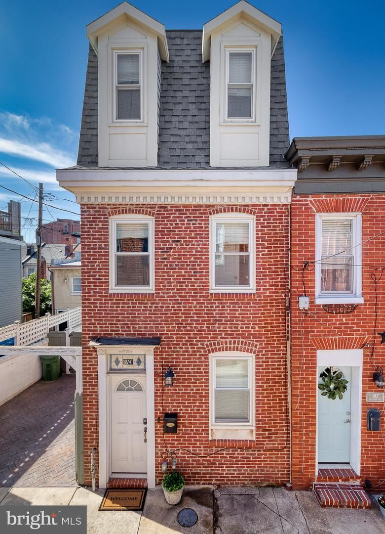 Photo of 914 S BELNORD AVE, BALTIMORE, MD 21224 (MLS # MDBA2000366)