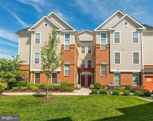 Photo of 43031 FOXTRAIL WOODS TER #104, ASHBURN, VA 20148 (MLS # VALO411376)