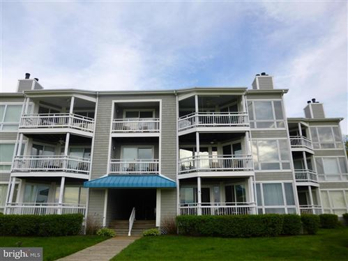 Photo of 110 OYSTER COVE DR #110, GRASONVILLE, MD 21638 (MLS # MDQA143442)