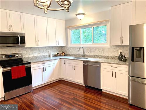 Photo of 2015 DUNDEE RD, ROCKVILLE, MD 20850 (MLS # MDMC724450)
