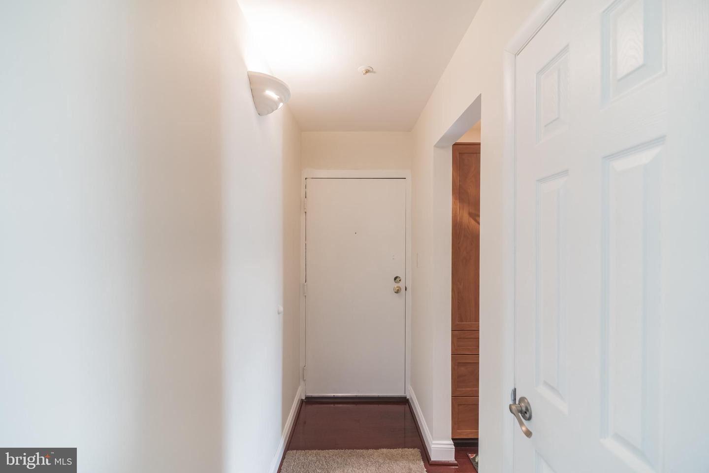 Photo of 7802 GUILDBERRY CT #303, GAITHERSBURG, MD 20879 (MLS # MDMC735460)