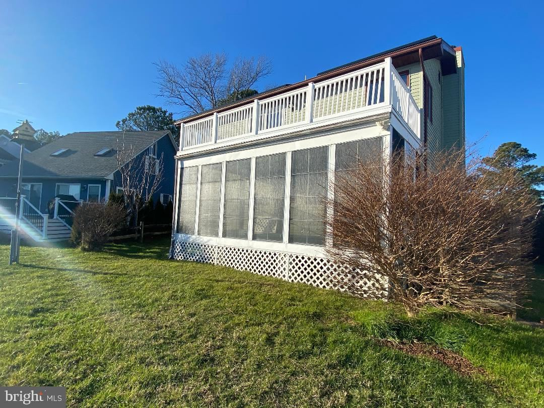 Photo of 7 CLUBHOUSE DR, OCEAN PINES, MD 21811 (MLS # MDWO121484)