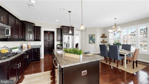 Photo of 726 RIVER MIST DR #221, OXON HILL, MD 20745 (MLS # MDPG2001496)
