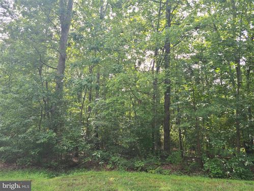 Photo of 410 HAPPY CREEK RD, LOCUST GROVE, VA 22508 (MLS # VAOR137508)
