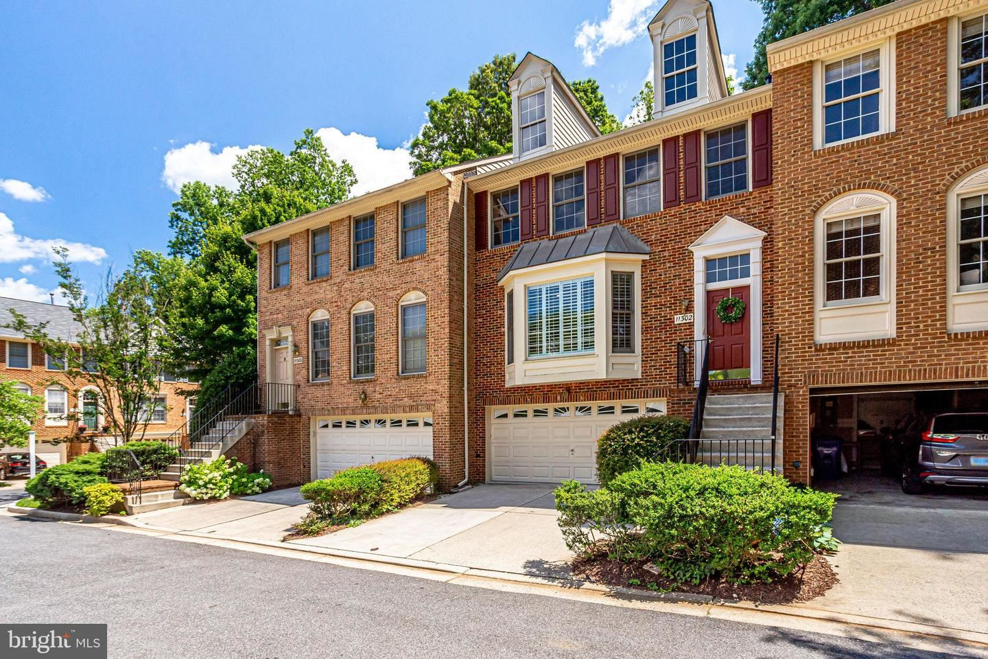 Photo of 11302 HOLLOWSTONE DR, ROCKVILLE, MD 20852 (MLS # MDMC713552)