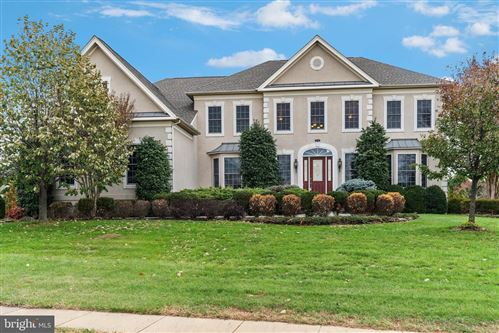 Photo of 22774 MOUNTVILLE WOODS DR, ASHBURN, VA 20148 (MLS # VALO398568)