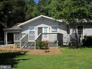 Photo of 413 HARRISON, LOCUST GROVE, VA 22508 (MLS # VAOR139580)
