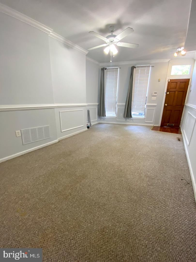 Photo of 315 S FREMONT AVE, BALTIMORE, MD 21230 (MLS # MDBA524606)