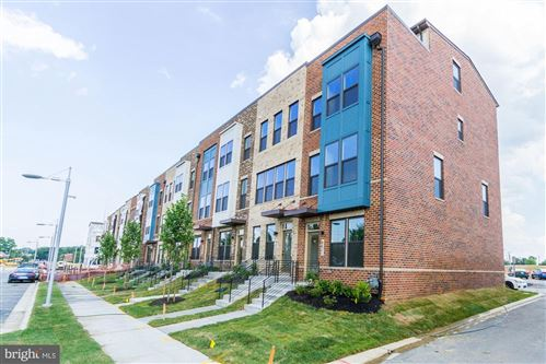 Photo of 2819 EVANSGREEN DR #1007 D, SUITLAND, MD 20746 (MLS # MDPG560612)