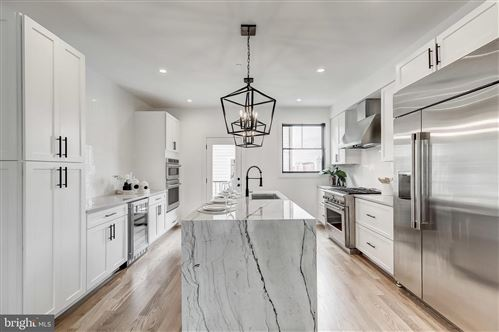 Photo of 1402 OLIVE ST, BALTIMORE, MD 21230 (MLS # MDBA520622)