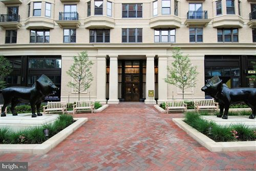 Photo of 7710 WOODMONT AVE #418, BETHESDA, MD 20814 (MLS # MDMC750628)