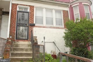 Photo of 2715 W NORTH AVE, BALTIMORE, MD 21216 (MLS # MDBA547636)