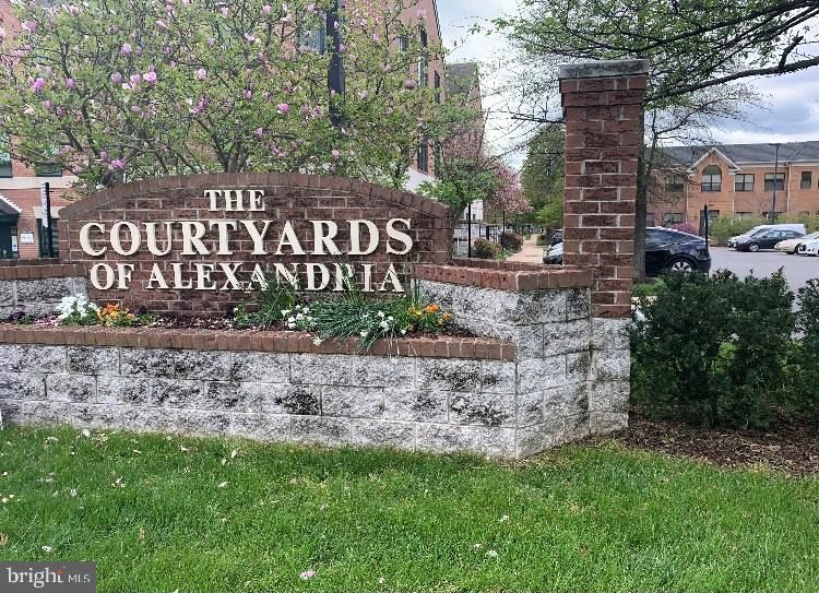 Photo of 6418 GROVEDALE DR #301, ALEXANDRIA, VA 22310 (MLS # VAFX1196652)