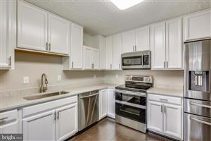 Photo of 7420 WESTLAKE TER #207, BETHESDA, MD 20817 (MLS # MDMC668658)
