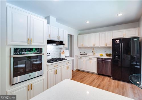 Photo of 3917 FOREST GROVE DR, ANNANDALE, VA 22003 (MLS # VAFX2005690)