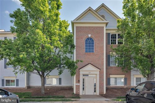 Photo of 1127 HUNTMASTER TER NE #301, LEESBURG, VA 20176 (MLS # VALO411692)