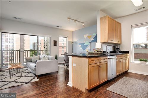 Photo of 8045 NEWELL ST #406, SILVER SPRING, MD 20910 (MLS # MDMC713710)