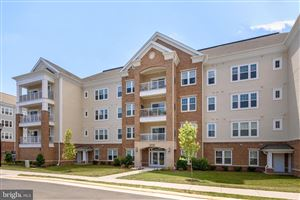 Photo of 20515 LITTLE CREEK TER #102, ASHBURN, VA 20147 (MLS # VALO388722)
