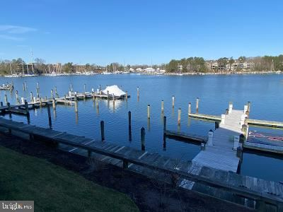 Photo of 614 OYSTER BAY PL #204, SOLOMONS, MD 20688 (MLS # MDCA181732)