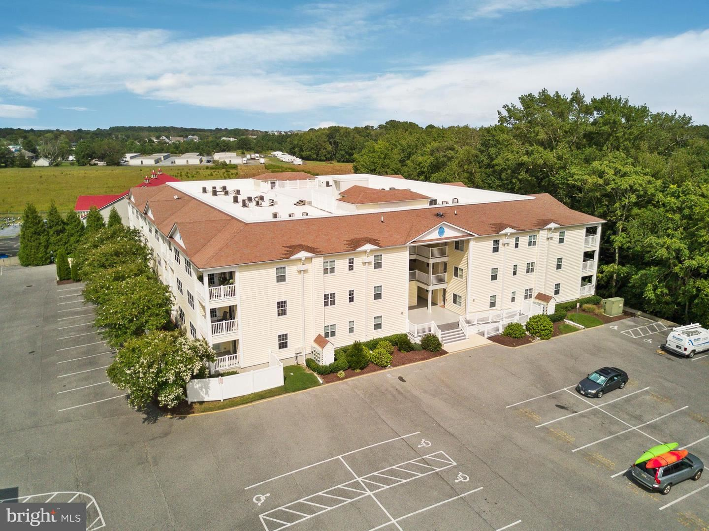 Photo of 30413 CEDAR NECK RD #203, OCEAN VIEW, DE 19970 (MLS # DESU169754)
