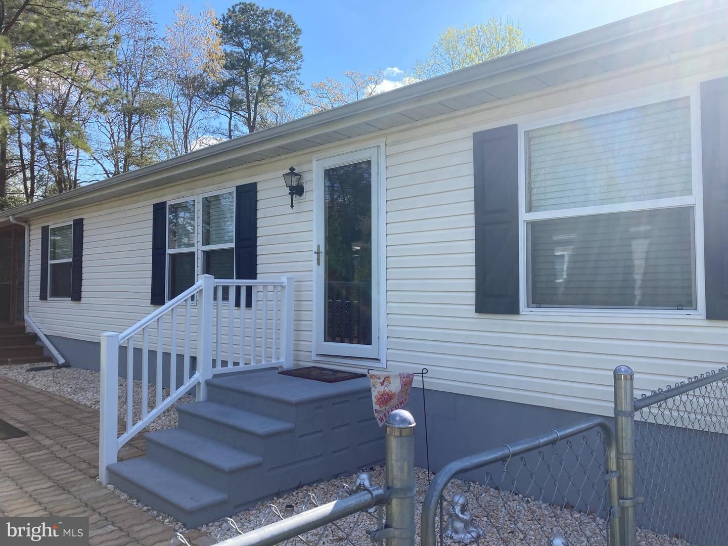 Photo of 107 WHITE PINE DR, MILLSBORO, DE 19966 (MLS # DESU182782)
