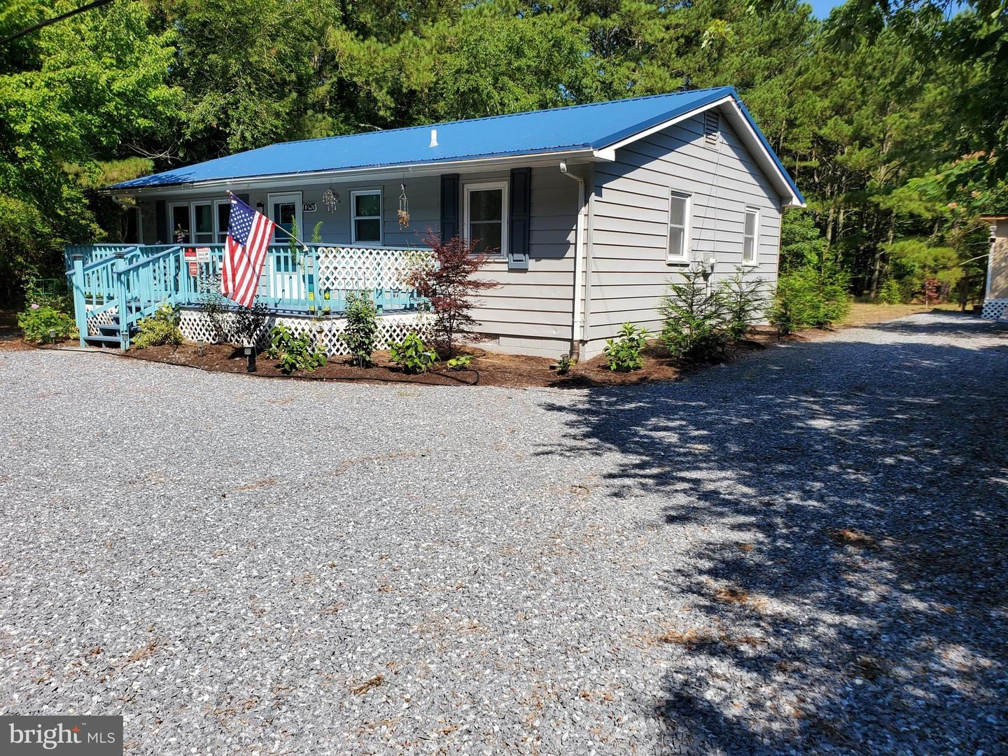 Photo of 10253 HARRISON RD, BERLIN, MD 21811 (MLS # MDWO115792)