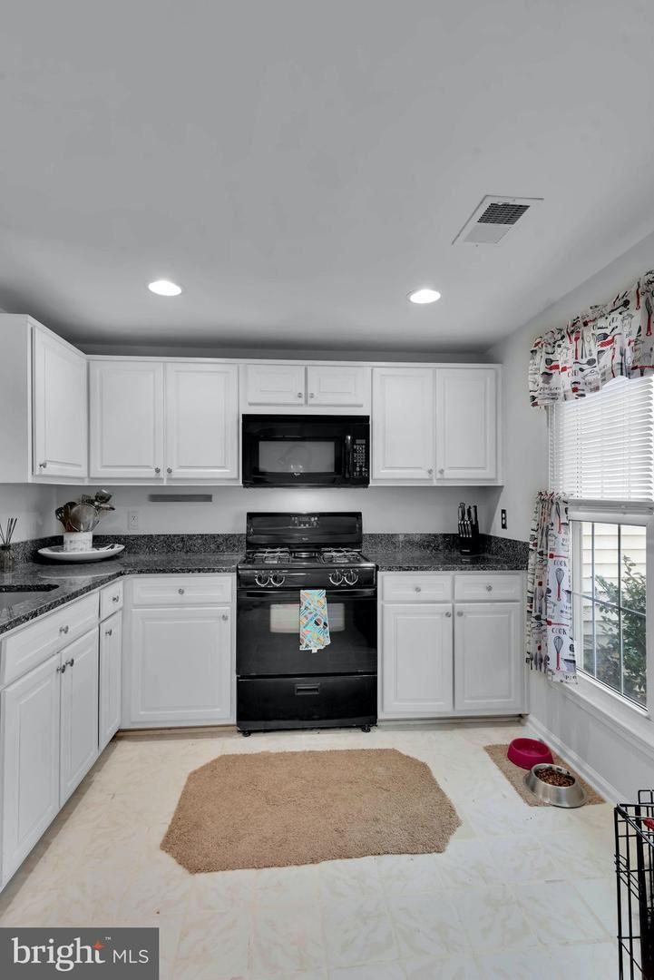 Photo of 14304 LITTLE ROCKY MOUNTAIN CT, CENTREVILLE, VA 20120 (MLS # VAFX1143796)