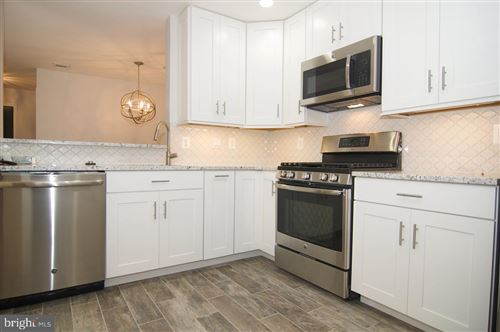 Photo of 15305 DIAMOND COVE TER #7-L, ROCKVILLE, MD 20850 (MLS # MDMC728828)