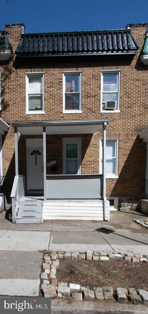 Photo of 3047 FRISBY ST, BALTIMORE, MD 21218 (MLS # MDBA516828)