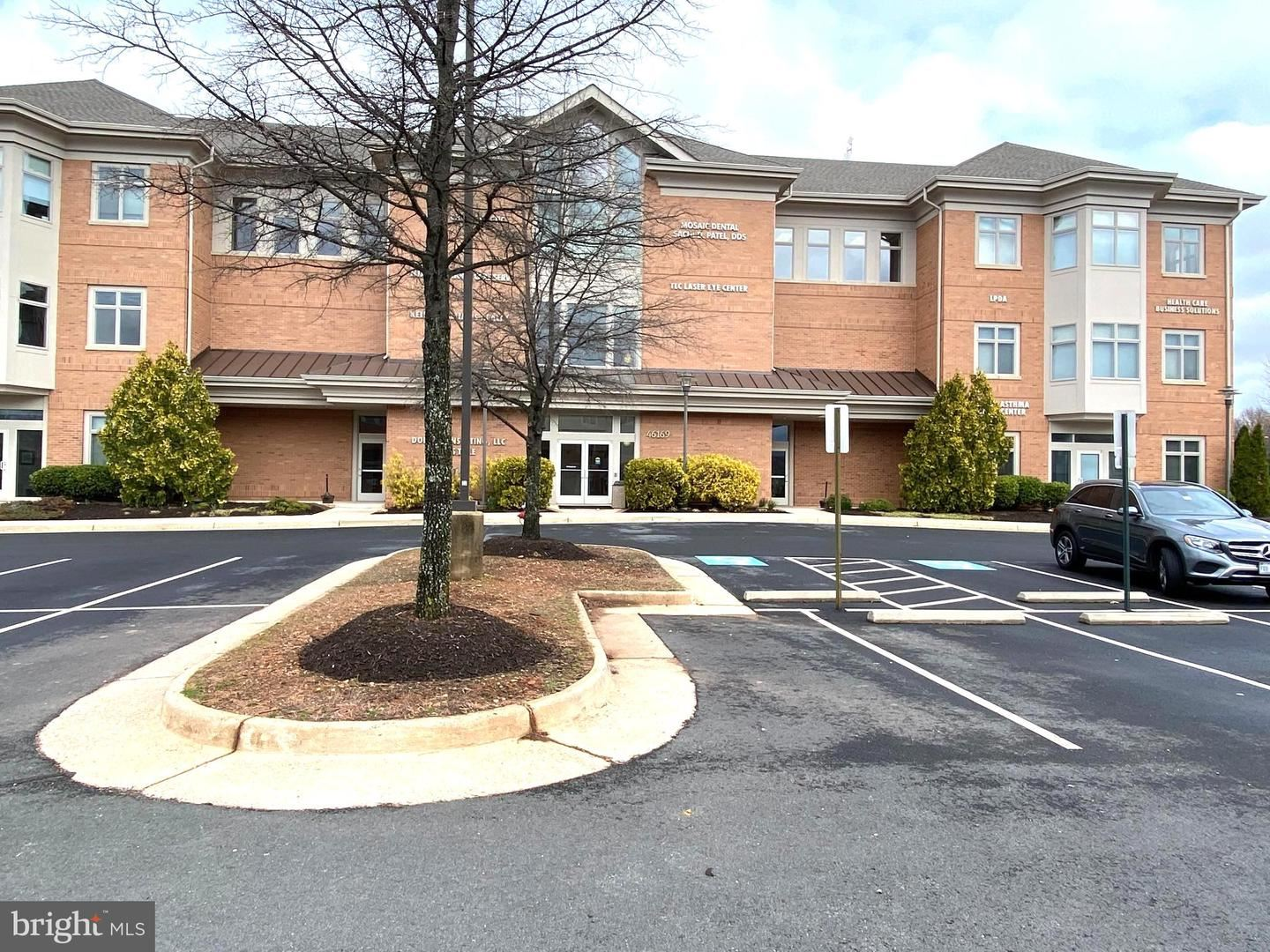 Photo of 46169 WESTLAKE DR #130, STERLING, VA 20165 (MLS # VALO436828)