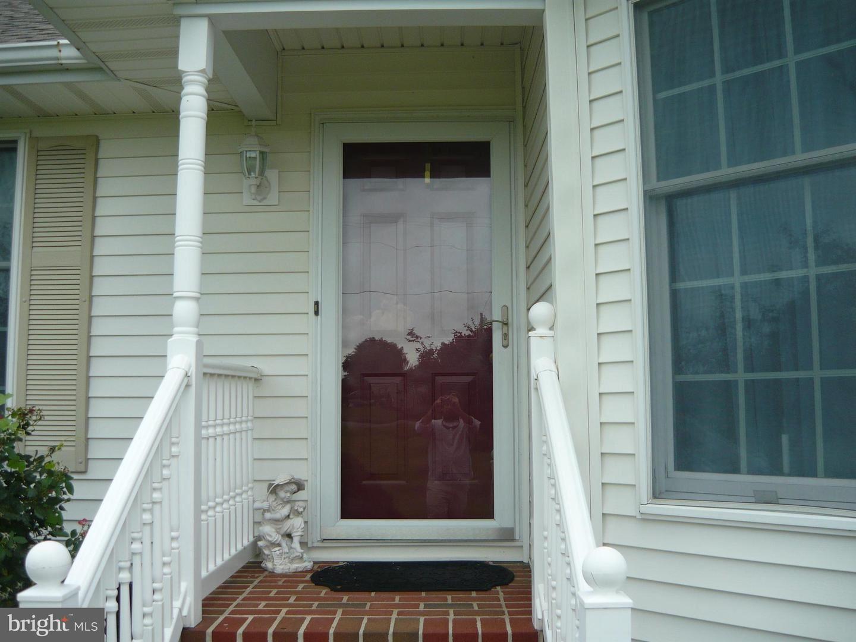 Photo of 4302 BLINK HORN RD, HURLOCK, MD 21643 (MLS # MDDO125850)