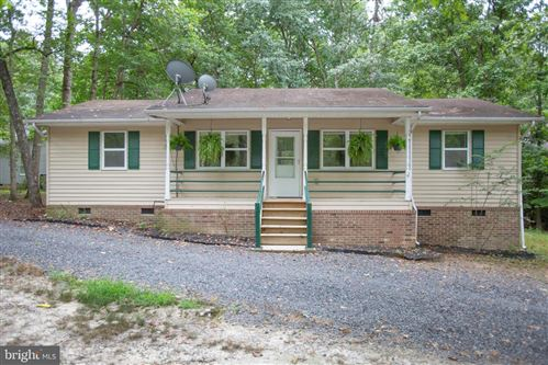 Photo of 100 CREEKSIDE DR, LOCUST GROVE, VA 22508 (MLS # VAOR134884)