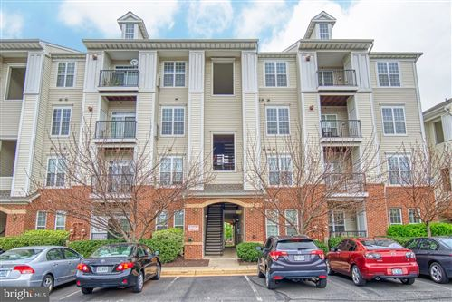 Photo of 21228 MCFADDEN SQ #414, STERLING, VA 20165 (MLS # VALO406888)