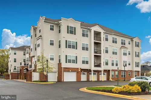 Photo of 9200 CHARLESTON DR #303, MANASSAS, VA 20110 (MLS # VAMN139896)