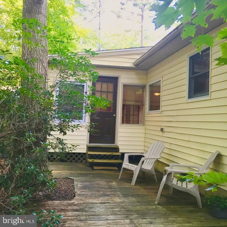 Photo of 34 BEACONHILL RD, OCEAN PINES, MD 21811 (MLS # MDWO115908)
