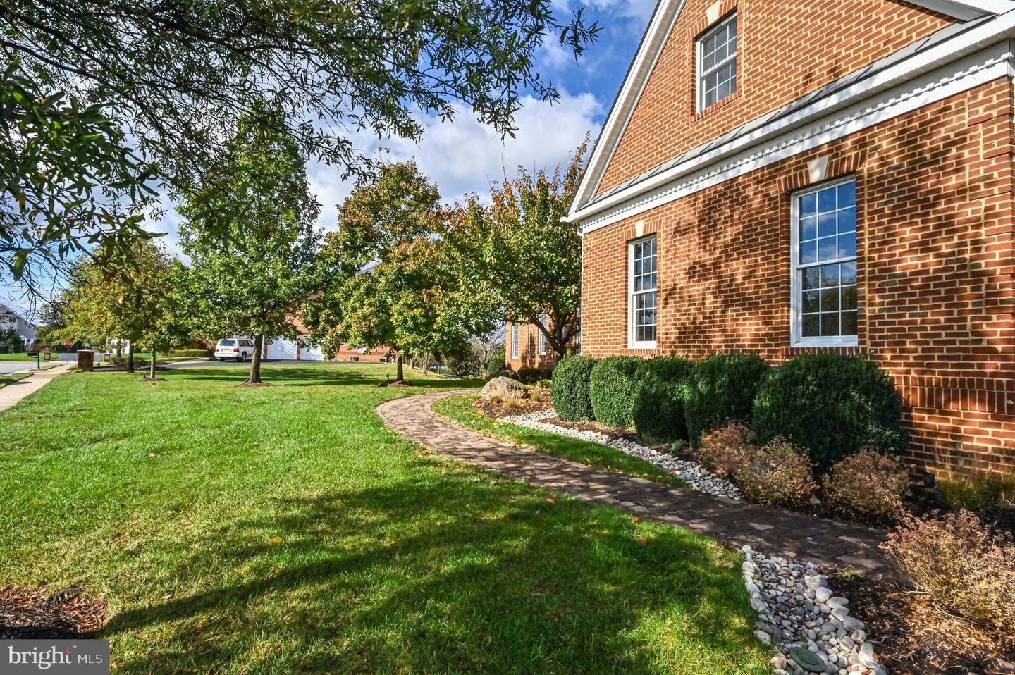 Photo of 22770 MOUNTVILLE WOODS DR, ASHBURN, VA 20148 (MLS # VALO424918)