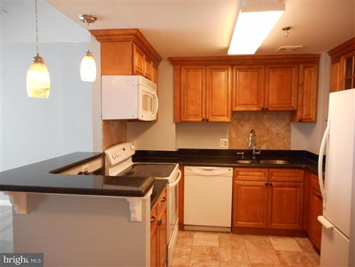 Photo of 24 COURTHOUSE SQ #211, ROCKVILLE, MD 20850 (MLS # MDMC676924)