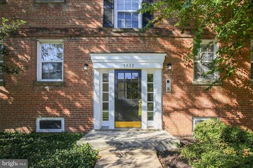 Photo of 1812 W ABINGDON DR #101, ALEXANDRIA, VA 22314 (MLS # VAAX252946)