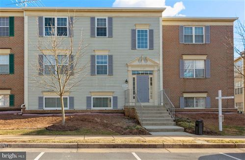 Photo of 1137 HUNTMASTER TER NE #202, LEESBURG, VA 20176 (MLS # VALO431992)