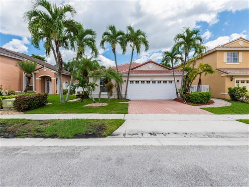Photo of 19033 NW 12th Ct, Pembroke Pines, FL 33029 (MLS # A10907009)