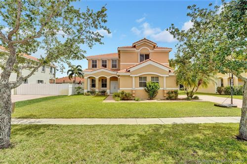 Photo of 16384 NW 16th St, Pembroke Pines, FL 33028 (MLS # A10865019)