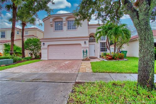 Photo of 15647 NW 12th Mnr, Pembroke Pines, FL 33028 (MLS # A10894022)